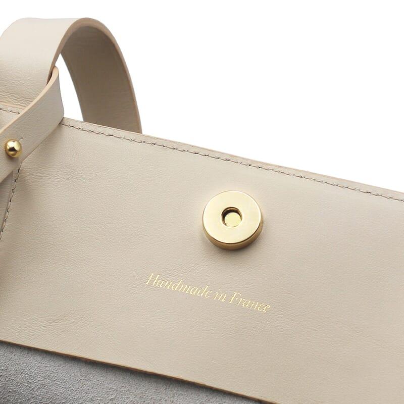 gros plan poche plaquée intérieure du Sac cabas cuir beige Jules & Jenn